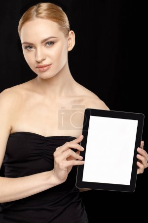 Foto de Woman showing digital tablet in hands isolated on black - Imagen libre de derechos