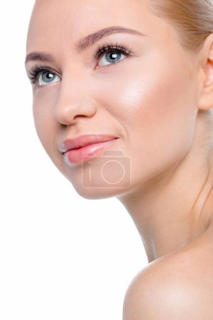 Photo pour Close-up portrait of young charming woman looking away isolated on white - image libre de droit
