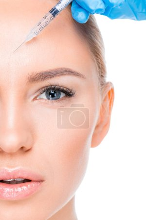 Photo pour Partial view of woman getting botox injection  isolated on white - image libre de droit