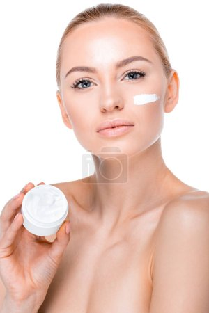 Photo for Portrait of woman showing face cream and looking to camera isolated on white - Royalty Free Image