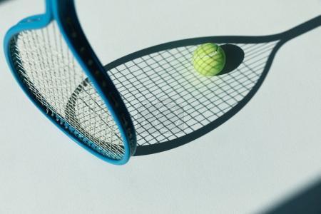 tennis racket and ball on floor
