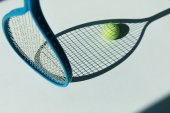 tennis racket and ball on floor