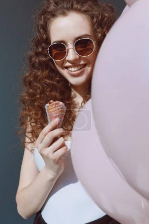 girl in sunglasses eating ice cream
