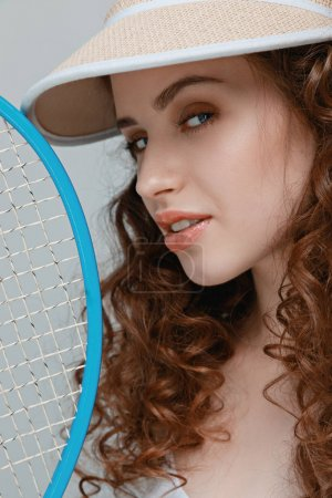 Young woman with racket