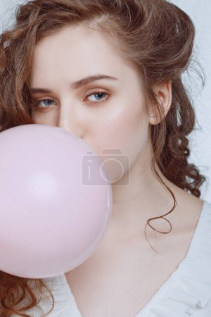 hipster girl blowing bubble gum