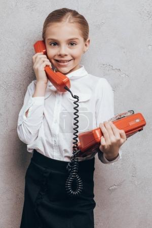 Smiling child with telephone