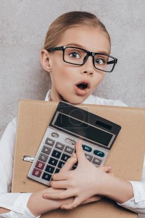 child with folder and calculator