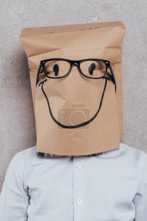 child with paper bag on head and eyeglasses