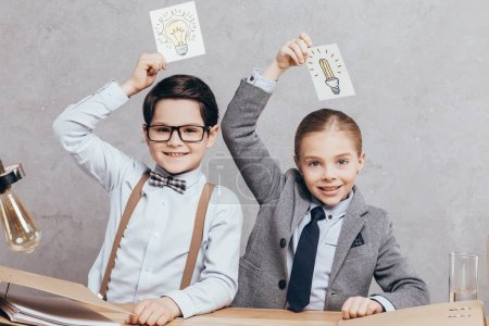 kids holding cards with ides sign