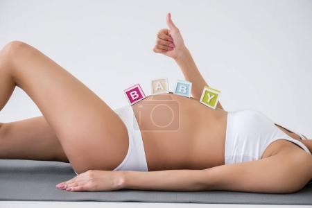 Pregnant woman with baby word