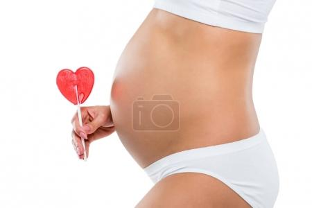 pregnant woman with lollipop