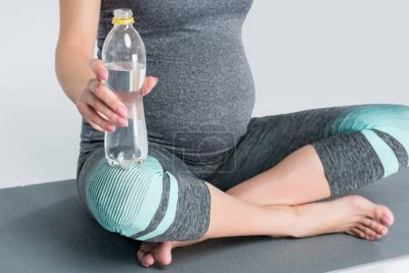 pregnant woman with bottle of water