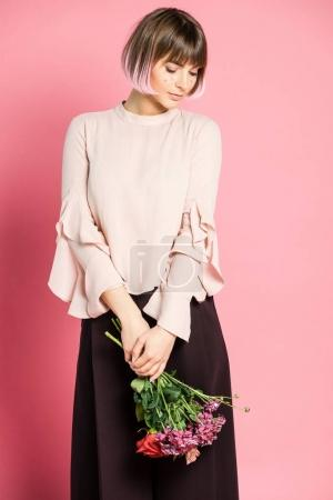 Trendy woman holding flowers