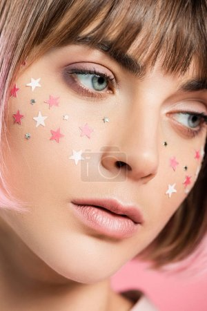 woman with pink stars on face