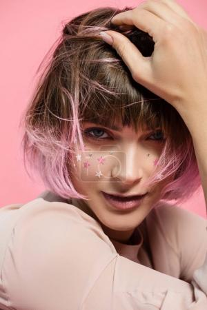woman with party makeup and pink hair