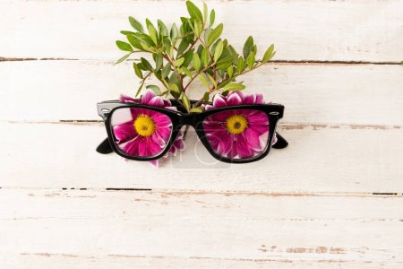 Eyeglasses and pink flowers