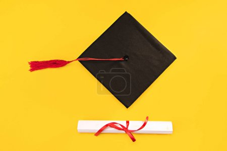 Photo for Top view of graduation mortarboard and diploma on yellow background, education concept - Royalty Free Image