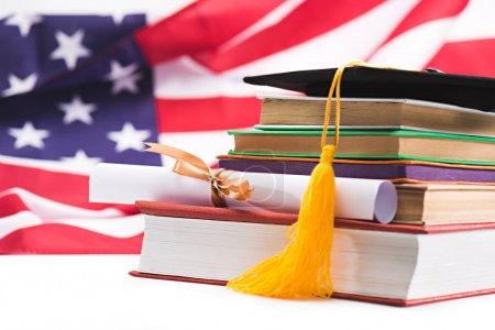 Graduation mortarboard and diploma