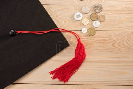 Graduation mortarboard and coins