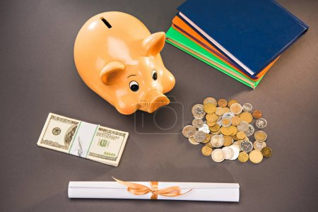 diploma and piggy bank