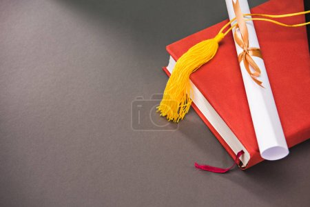 Books, diploma with copy space