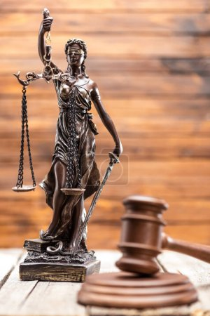Photo for Statue of lady justice and mallet on wooden table, Law concept - Royalty Free Image