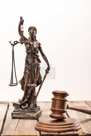 Statue of lady justice and mallet
