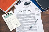 Contract and calculator at workplace
