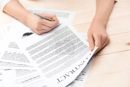 businesswoman signing contract