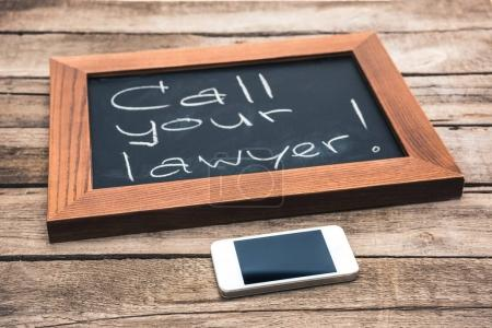 smartphone and chalkboard in wooden frame