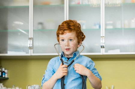 boy with stethoscope at clinic