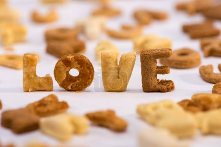 Photo for Close-up view of word love and healthy breakfast cereal alphabet isolated on grey - Royalty Free Image