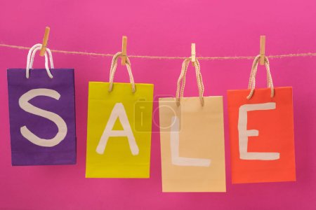 Sale signs on shopping bags