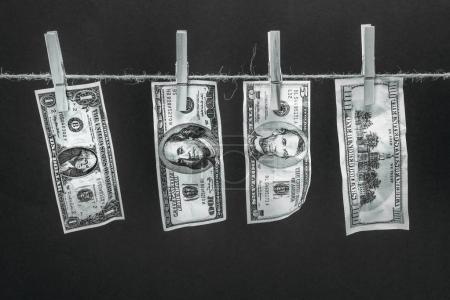 Dollar banknotes hanging on rope
