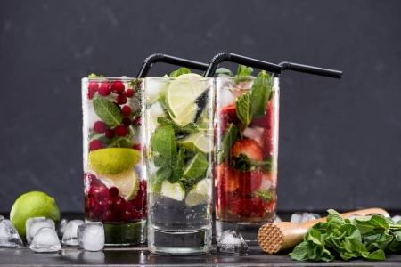 Photo for Different fresh lemonades in glasses with ice cubes, cocktail glasses concept - Royalty Free Image