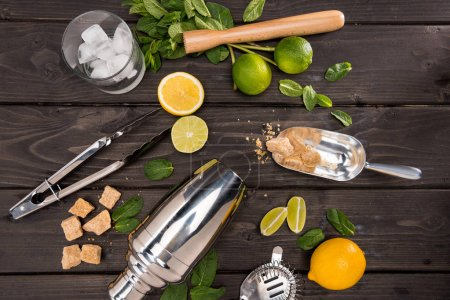 Photo for Top view of mojito cocktail ingredients and utensils on wooden table top, cocktail drinks concept - Royalty Free Image