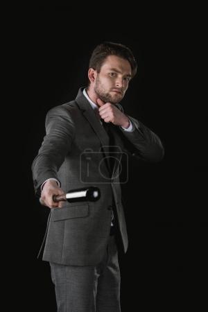 Serious businessman with bat