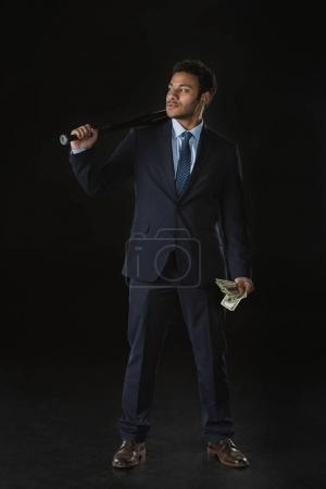 Businessman with bat and money