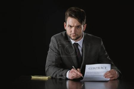 businessman in suit with contract