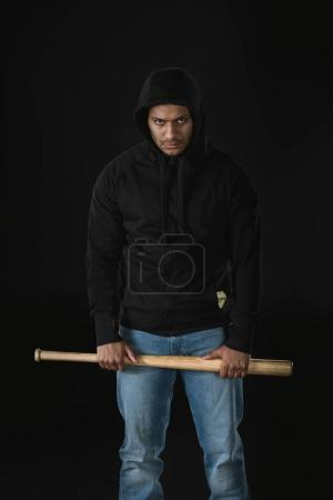 african american robber with baseball bat