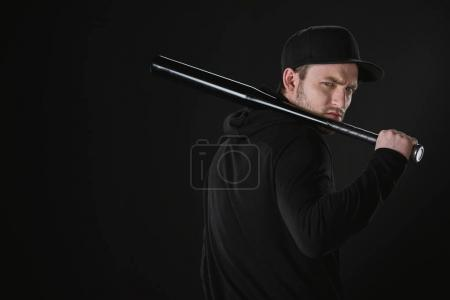 Young robber in zoodie with baseball bat