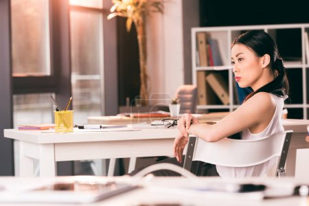 asian businesswoman sitting in office