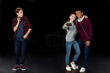 Boy jealously looking at couple