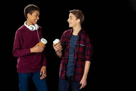Teen boys with paper cups of coffee