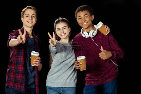 teenagers with paper cups of coffee