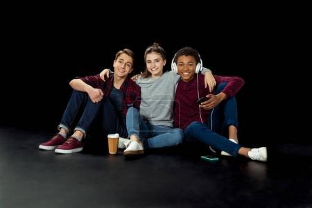 teenagers sitting on floor