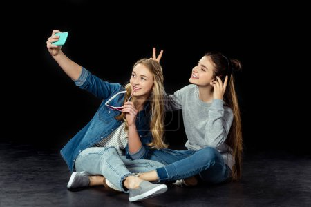 teen girls taking selfie