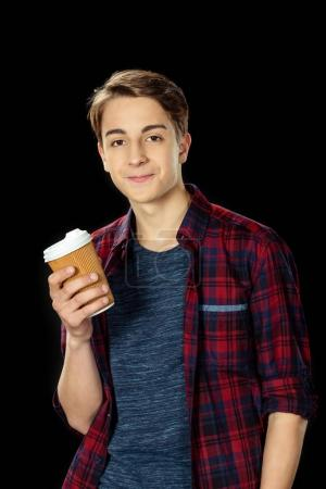 teen boy with cup of coffee to go