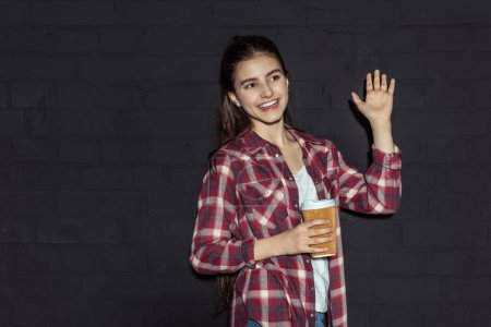 girl with coffee waving hand