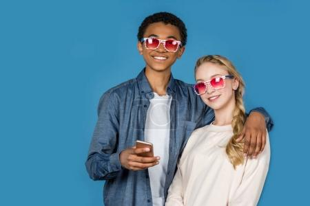 teens in pink glasses with smartphone